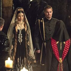 Here comes the bride, all dressed in...her League of Assassins costume?! Wedding bells are ringin...