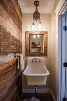 Check out this amazing sink and overhead light in the guest lav of our Main Street Farmhouse plan. Visit to see more on this amazing post and beam currently being built. #farmhouse