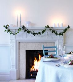 Christmas Simplicity - White with green.    I want a fireplace thats pretty and white, and chair that is blue