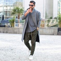 Consider teaming a grey overcoat with army green trousers for a dapper casual get-up. Feeling brave? Complete your look with white low top sneakers.   Shop this look on Lookastic: https://lookastic.com/men/looks/overcoat-crew-neck-t-shirt-chinos/23629   — Dark Brown Sunglasses  — Grey Crew-neck T-shirt  — Grey Overcoat  — Gold Watch  — Olive Chinos  — White Low Top Sneakers