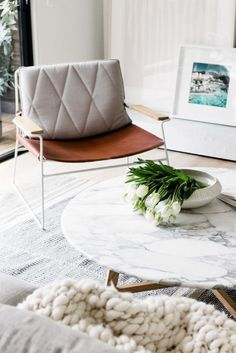 Marble coffee table with grey living room interior | Image via lextravagance.tumblr.com