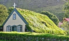 Although sod-topped structures may seem like they're straight out of a movie, the fascinating earthen-enclosed Hofskirkja church was built in 1884.