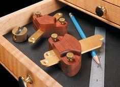 Exotic wood and polished brass come together in a pair of handy layout tools.
