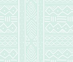 Mudcloth in white on mint by domesticate, wallpaper