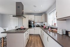 A contemporary kitchen with modern appliances completed with a stainless steel double oven, gas hob and an extractor hob. Stainless Steel Double Oven, Kings Home, New Homes For Sale, New Builds, Contemporary, Modern, Luxury Homes, Appliances, Interiors