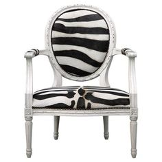 This unexpected pairing of Global Bazaar and French Country style brings a pop of black and white whimsy to a bedroom or seating area. The bold zebra pattern pops against the traditional hand-carved antique white frame with a tailored nailhead trim.