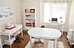 I like this craft room with permanent sewing station, center table simply painted over, etc