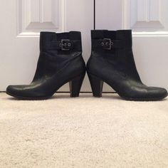 Heeled black boots with buckle 3 inch heeled boots. A little worn (see second picture) but can be easily fixed to look brand new again. Very cute! Bandolino Shoes