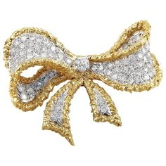 Cellino Diamond Platinum Gold Bow Brooch | From a unique collection of vintage…