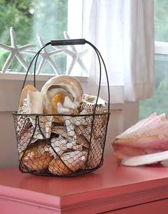 Large shells used in a wire basket.  Perfect for the basket on the console table in the summer.