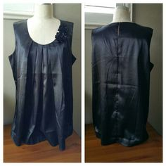 """Comfortable Black Sleeveless Dress Top Comfortable Black Sleeveless Dress Top with Roses on the collar and a Keyhole in back in EUC with no flaws. Great piece for the office. Measurements are: Length is 30"""", Bust width is 22"""", widest width at the bottom is 29"""". Located in Poshmark closet @taylord2covet. Tops Blouses"""
