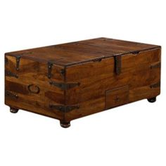 Loon Peak Mapleton Trunk Coffee Table   $721.99 Rather nifty with storage and can be used with top flipped open.  Again, + castors