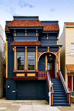 San Francisco Dream House. Sits in a row but you would never mistake it. That dark blue is rich  in contrast with the gold and reds