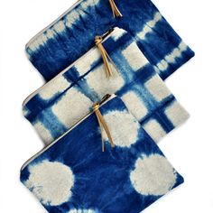 A versatile zippered pouch, featuring fabric I dyed with indigo in a geometric stripe pattern. One side is Shibori indigo dyed linen/cotton, the
