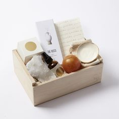 A Beautiful Beginning Gift Box - Golda Hiba Wood Atmosphere Mist. Purifying, uplifting, and stimulating with its woodsy, cedar-like scent with hints of citrus.   Golda Sphere Soap.  L'objet Thé Russe Incense:ruly exquisite Japanese-made incense sticks to enliven the senses, cleanse impurities and elevate the mood. Scented with lemon zest, coriander, patchouli, amber and Russian leather.  Simone LeBlanc Foil Stamped Gratitude Journal