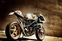"This beautiful build is based on a Ducati Monster S2R 1000. What Radical Ducati have created is now known as ""RAD to HELL"". This is the bike some of us wish Ducati would build. The S2R 1000 engine has been tuned by Radical Ducati by adding ported heads, racing-style filters, and a Wolfman exhaust system. The ECU is upgraded to an EVR 3 ecu, and an EVR slipper clutch helps put the power to the ground."
