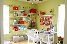 Red and green craft room with wall shelves for storage.  Makes it look like a mini store...really like the concept.
