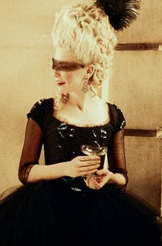 Marie Antoinette - Kirsten Dunst wearing a black tulle ballgown with sheer sleeves and beaded appliqués on the bodice and shoulders. Her mas...
