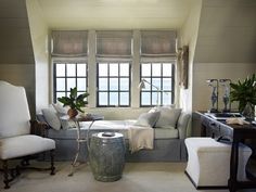 Settee tucked back into the three window dormer. Wood walls and ceiling painted the same color. Wonderful chair. - by South Shore Decorating Blog