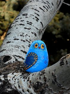 Whimsical owl in shades of blue hand painted on river rock