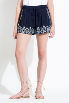 These casual shorts add a feminine touch with the floral embroidery perfect for spring break outfits!
