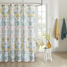 Update your space with the Mona Collection for a bohemian look. This unique pattern features floral medallions and bird motifs in a mirror layout with bright shades of yellow, orange and teal for a beautiful update to your space