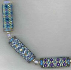 Google Image Result for http://www.lindarichmond.com/files/bb_blue_necklace_with_dichroic_no_charms_crop_50pct.jpg