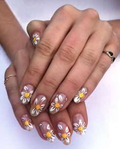 Pushing daisies, try this floral inspired manicure, perfect and festive for Spring. Try all nails or one or two for a slightly detail.