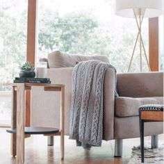 """Now with thicker braided cables, this new cable throw has the added """"chunkiness"""" that we're always looking for! Simple texture and subtle knitted pattern allow"""