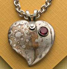 Free project download: learn metal fabrication, stone setting, and working with mokume gane in this lovely project. Mokume Gane Heart Pendant by Roger Halas on Jewelry Making Daily