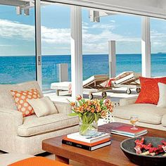 Go bold with color. Here, a coral collection became the basis for the home's red-orange color scheme. Coastalliving.com