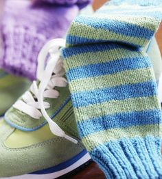 Two Knock-Out Socks You Can Knit...Skill Level: Easy...Warm your toes with striped tube socks knit in fun and fancy colors. They stay put with comfy banded cuffs.