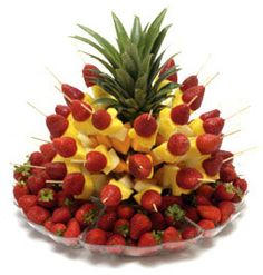 fruit kabob display in a pineapple. Cute.
