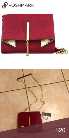 Nicole Miller Deep Winterberry Clutch Bag Winterberry Clutch bag with chai link strap to wear across body or on shoulder. New With Tags. Nicole Miller Bags Clutches & Wristlets