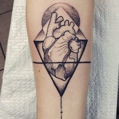 Heart tattoo with Geometric design elements and dot work by @jakedoestattoos…