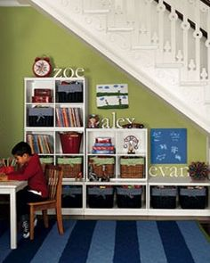 playroom-I love this under the stairs!!  For space at bottom of stairs