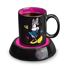 Disney Minnie Mouse Mug Warmer, Black/Pink - Keep your coffee or tea at just the right temperature with this Minnie Mouse Mug Warmer. Perfect for home or the office, this mug warmer features a Minnie shaped power light and the 10-ounce Minnie Mouse mug is included. Features include an illuminated power switch, and an extra-long cord with co...
