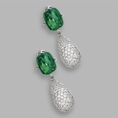 EMERALD AND DIAMOND PENDANT-EARCLIPS The tops set with 2 sugarloaf cabochon emeralds weighing approximately 17.85 carats, suspending 2 pendants pavé-set with numerous round diamonds weighing approximately 9.60 carats, mounted in 18 karat white gold, pendants detachable.