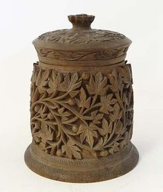 """An Early 20thC Anglo Indian carved hardwood copper lined tobacco pot 6 1/2"""" high"""
