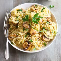 Spaghettini with Mushrooms, Garlic, and Oil | We've added sautéed mushrooms to the classic—and very simple—spaghetti with garlic and oil, but the dish can still be made in no time at all. Regular white mushrooms are excellent here; portobellos or wild mushrooms would be great, too.