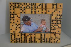 A box of old dominoes becomes a new DIY picture frame with some liquid nails. Found beauty! Frame Crafts, Diy Frame, Fun Crafts, Diy And Crafts, Domino Crafts, Domino Art, Cool Picture Frames, Marco Diy, Foto Baby