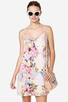 Summer wouldn't be summer without an easy breezy floral dress!  This one has a super sexy low bac...