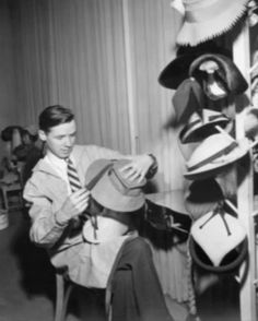 Bill Cunningham hat designer for a short time before the armed services.