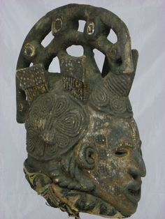 "Impressive African Tribal Mask Igbo Maiden Spirit Mask    Dimensions without the base: 17""H x 10"" x 15""  Mid 20th Century  If you want more pictures just let me know.....  Conditions: wood deterioration, age cracks & old repair, chips and scrapes, overall condition good.  Base is included with Mask    FREE SHIPPING WORLDWIDE !    Maiden masks are used for funerals of prominent society members. On latter   occasions maiden spirits are invoked alongside other spirits as appropriate escorts of…"