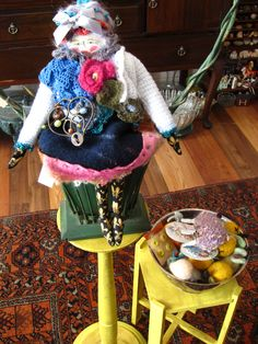 art doll sitting in basket in my boutique