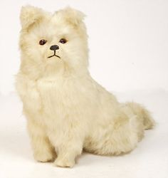 www.liveauctioneers.com item 41160977_skin-dog-candy-container-with-glass-eyes-seat-height