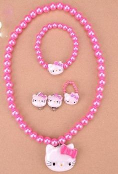 Hot Pink Childrens Girls Jewelry 5pc Hello Kitty Faux Pearl Set Which Includes Necklace, Clip on Earrings, Stretch Ring & Stretch Bracelet. Perfect for Christmas, First Communion, Easter, Graduation, Sunday Dress, Christening or Birthday. Value Line, http://www.amazon.com/dp/B00A2BOYPY/ref=cm_sw_r_pi_dp_AqVRqb1N8RVHQ