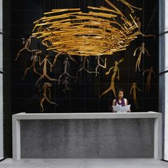 """Nest"" Dimensions shown: 2700 dia x 700mm (8' 10"" dia x 2' 3""). Material: Brass / White Powdercoated aluminium. Design: Richard Neville. YellowGoatDesign"