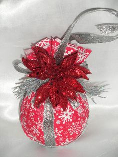 Christmas Ornament. Fun for children.  Styrofoam ball, fabric, ribbon, flower or other decoration and done.