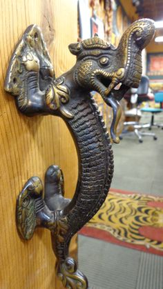 """Bronze dragon door pull.  Hand crafted in the old Himalayan KIngdom of Patan by traditional artisans.  10.5"""""""